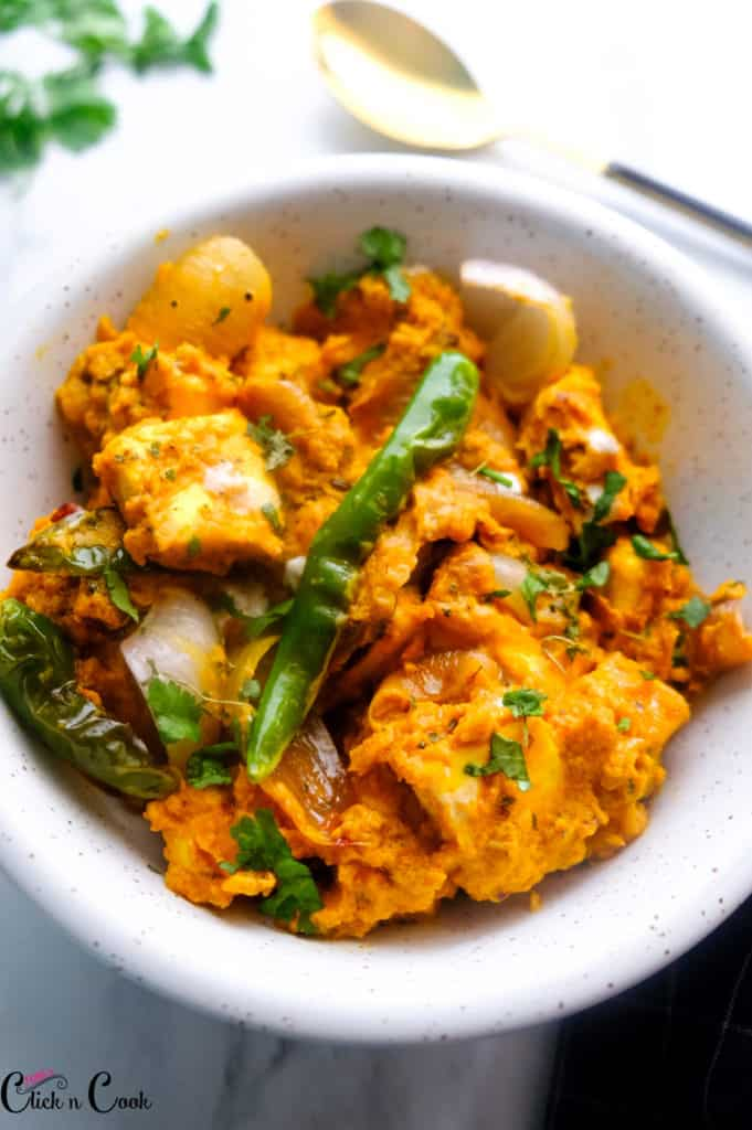 Paneer Do Pyaza served in white bowl