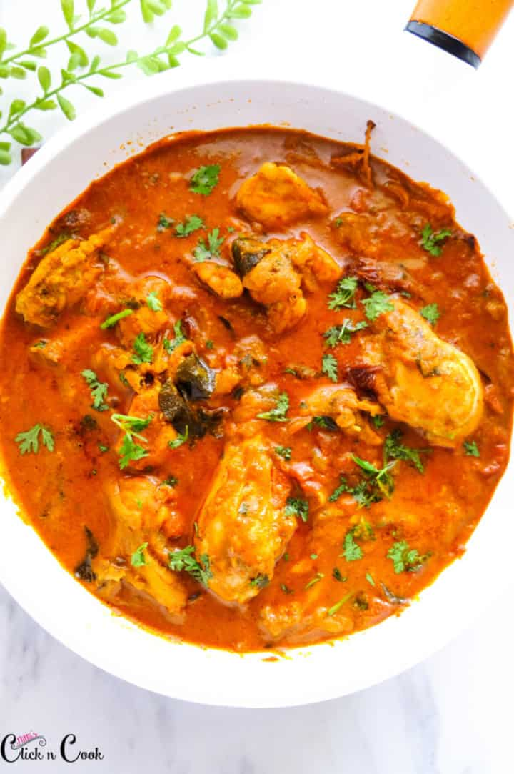 chicken coconut in a white pan