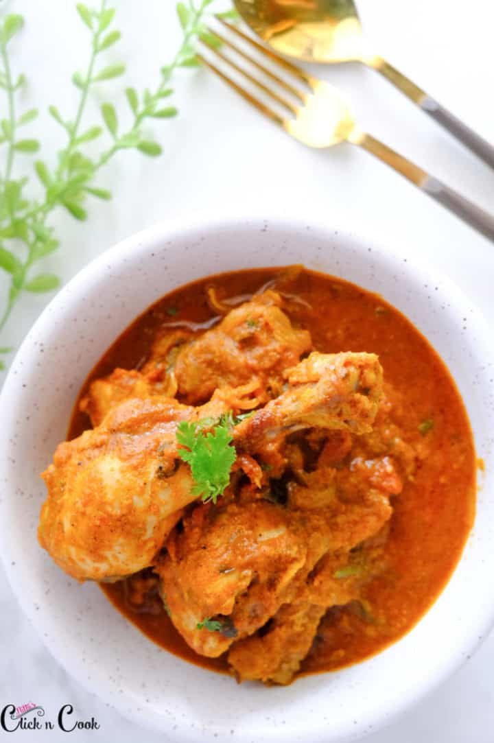 chicken coconut curry served in white bowl