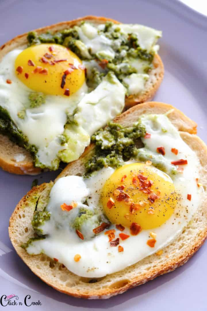 close up short of pesto eggs served over the toast