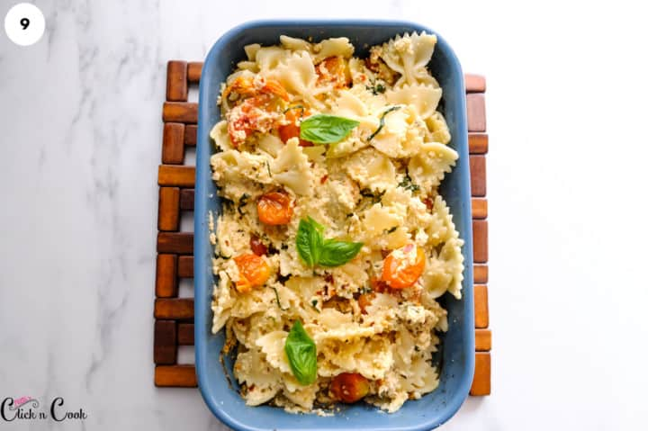 feta cheese on pasta in blue baking dish