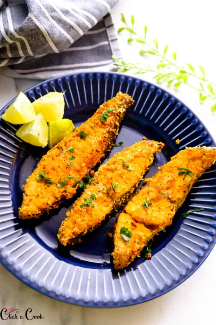 Air Fryer fish served in blue plate