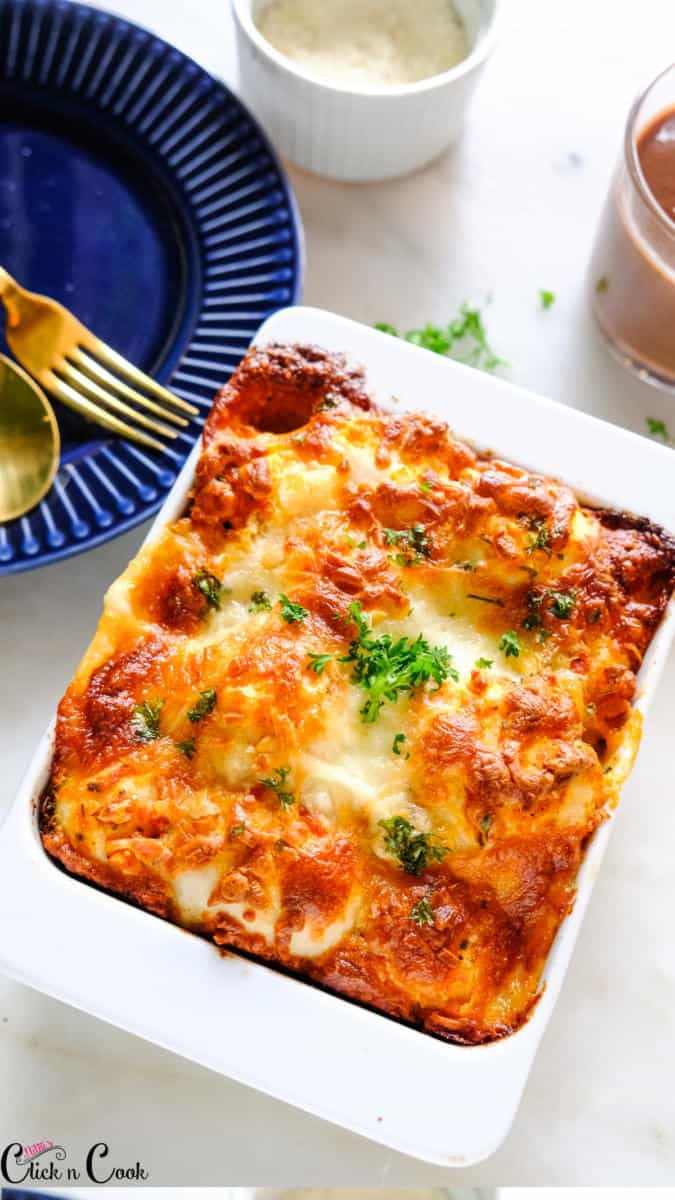 cheese, pizza dough in white baking tray